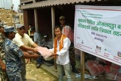 PEEDA-team-distributing-tarpaulin-to-the-earthquake-affected-families-of-Okhaldhunga-district