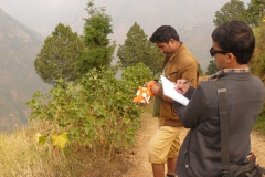 PEEDA-team-taking-measurement-of-Jatropha-plant-during-end-line-survey-at-Okhaldhunga-district