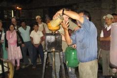 Adding the Jatropha bio-fuel to the fuel tank for testing.