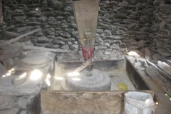 Traditional Grinding Stone operated by running water, grinding food grains to make flour. The Nepali name is Ghatta.
